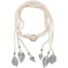 Pre-owned 2003s CHANEL Tripple Pearl Strand Clear Camellia Flower And... ($1,480) ❤ liked on Polyvore featuring jewelry, necklaces, multi-strand necklaces, leaf necklace, tie necklace, multi strand pearl necklace, multi strand chain necklace and white pearl necklace