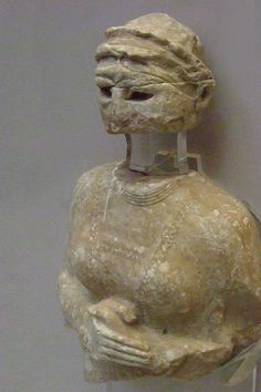 Stone statue of a woman Neo-Sumerian 2150-2000 BCE