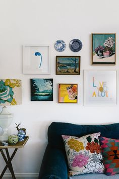 A gallery wall in the living area features work by artists Rachel Castle, Sam Michelle and Ali Wood. It has morphed over the past year in a mixture of landscapes and still life paintings Country Style Magazine, Weatherboard House, Queenslander, Chintz Fabric, Oak Dining Table, Australian Homes, Mid Century House, New Wall, Colorful Decor