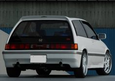E-AT Civic with Mugen back bumper, rear wing, skirts and exhaust(?).