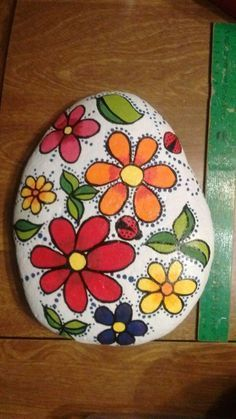 Image result for flower painted rocks
