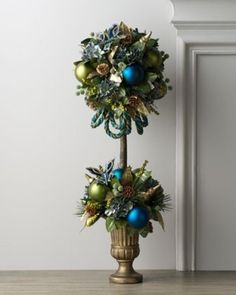 A peacock feather topiary adds a festive touch. I'd say that this site has at least 10 different topiary ideas; so cool!!!