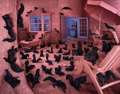 Before digital editing, American artist Sandy Skoglund created non-photoshopped scenes by building surreal sets, a process that took months to complete.