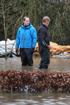 Prince William, Duke of Cambridge and Prince Harry help with flood defences around Eton End School on 14.02.14 in Datchet, UK