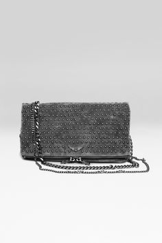Zadig et Voltaire iconic zipped clutch, studs all over, zipper with double slider, rectangular format that folds, with adjustable curb chain, interior patch pocket and welt pocket in the lining, little metallic wings rivet on the front, depth 2cm, height 15cm, length 27cm, shoulder strap length 78cm and 124cm, 100% suede. Twill cotton lining.