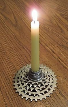 Recycled bicycle candle holder hub on top