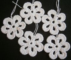 4ply cotton flowers with 2mm hook ... 2 rounds and you're done!