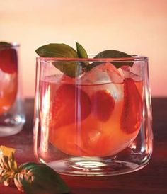 GREY GOOSE® CHERRY NOIR HAMPTONS PUNCH: 5 parts GREY GOOSE Cherry Noir Flavored Vodka, 4 parts fresh squeezed grapefruit juice, 3 parts strawberries and 1 part basil syrup.