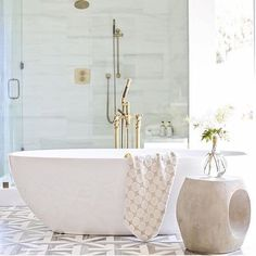 Here's another shot of a modern coastal bathroom that is just beyond dreamy  designed by the wonderful @tiffanygharris Her designs are stunning! I am in love with this tile and I cannot wait to share how it turned out in my own guest bathroom. Faucet and shower trim by @watermarkbrooklyn Tile floors by @marblesystems Architect @brandonarchitects Photographer @ryangarvin #bathroomdesign #interiordesign #marblesystems #marble #brandonarchitects #watermark #design #bathroomgoals