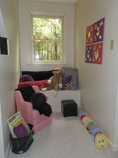 create a reading nook for kids - pillows, blankets, stuffed animals a chair their size and a basket of books