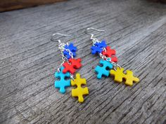 These beautiful autism awareness earrings were made entirely by me, a proud autism dad. Awesome yet tiny handmade polymer clay puzzle pieces in the