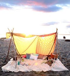 http://www.apartmenttherapy.com/how-to-pitch-a-bohemian-beach-tent-anywhere-165471