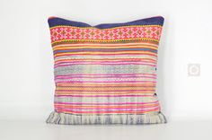 One of a kind bohemian decorative pillow cover made with vintage Hmong textiles and embroidery.  [ Front ] Vintage piece of Hmong block-print cotton fabric with traditional patterns and a variety of colorful applique lines. Top part carries a beautiful Hmong cross-stitch work on an indigo dyed hemp strip.  [ Reverse ] New indigo color 100% cotton handwoven fabric from traditional weavers village in Northern Thailand  [ Approx. Measurement ] 16 x 16 (40 cm x 40 cm)  [ Details ] Invisible…
