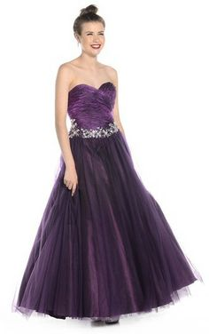 A stunning, deep aubergine, full skirted princess style prom dress from Ruby Prom.