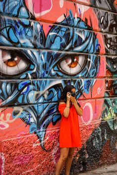 Taking pictures and exploring the street art in Callao Monumental - Callao, Lima - Peru