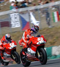 Loris Capirossi pulls over to allow team-mate Troy Bayliss past in Brno qualifying.