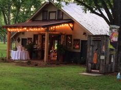 Big Barn lit up for a party Rustic Barn Wedding at The Fritz Farm Wedding Venue in Cordele, GA