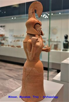 Large clay female figurine with helmet, dedicated to the sanctuary of Gortyna. The hand posture indicates that she held shild and spear, in the type of Athena Promachos, the goddess of wisdom and war. Crete, Gortyna, Archaic period, 7th. cent. BCE. Crete, Iraklion, AMI