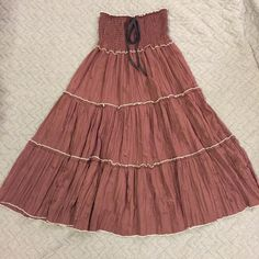 Brown Crinkle Dress This can be worn multiple ways... Strapless, as a halter or as a skirt!! Perfect for vacation to warm places because it's light and doesn't need to be ironed. Great as a bathing suit cover. Top is very stretchy. As a dress it goes down to the knee. Dresses Strapless
