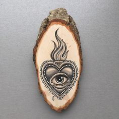 Wood slice with original drawing of a sacred heart / all seeing eye 'tattoo…
