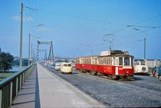 "A classic Volkswagen T1 Bus driving on a bridge called ""Reichsbrücke"" in Vienna, 1965. T1 Bus, Volkswagen Bus, Vienna Austria, Vintage Pictures, Old Photos, Window, History, Classic, Pictures"