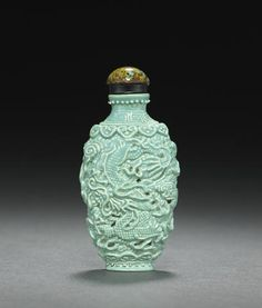 A molded and enameled porcelain 'dragon and phoenix' snuff bottle, Jiaqing mark and of the period