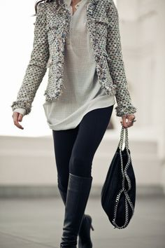 Tweed jacket with black leggings, boots and casual shirt.