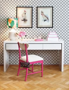 Instead of hiding your office area, make it stand out with color. We love how this pink chair makes the area pop.