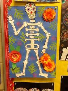 Day of the Dead Calavera / 3rd grade  Ribs of the skeleton could be made out of students name from a folded piece of paper and cut out!
