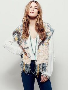 Rag Rug Vest   In different colors and textures this cropped vest looks good with anything.  Features statement fringe trim.