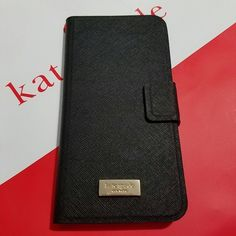 Kate Spade Leather Iphone 6 plus (black) Kate Spade Leather wrap folio Iphone 6 plus  • Color: Black • Material: sofiano leather • Brand new. Never used • Tag is included • No trade No hold kate spade Accessories Phone Cases
