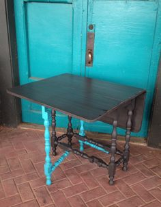 Gate leg, drop leaf table done in American Paint Company Gun Powder and Shoreline.