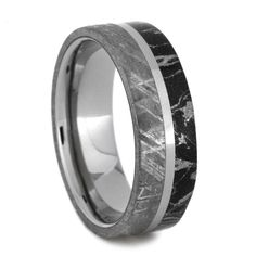 Finally a titanium wedding band that capture and hold your gaze. A mystifying meteorite as well as black and white mokume ring displays whimsical pattern...