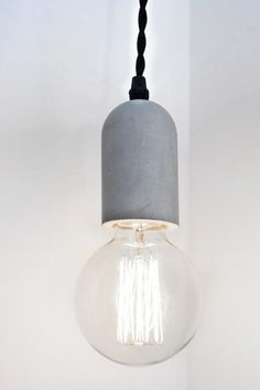 Barbican Shop Concrete Cylinder Pendant Lamp: This concrete pendant lamp adds a smart and modern look to any home or apartment. The lamp features a durable 3.7m cotton braided cable, a swag hook and a silicone socket. A bulb is not included but it is compatible with 3-way incandescent or LED bulbs (max. 60W) and CFL light bulbs (max. 20W).