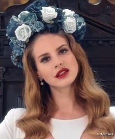 "Lana Del Rey wears a flowery crown for dramatic effect in the video for her song ""Born to Die""."