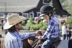 The kids eagerly listen to the pre-ride instructions before beginning their horseback riding vacations.