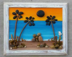 FREE SHIPPING  This will be made to order:  Adorable pebble art couple by the Ocean under two palm trees.  The background is hand painted in acrylics, and a light layer of sealant is used. Materials used are real desert plants, dried moss, sea shells, twigs, pebbles and rocks. The frame is open, measuring 8.5x11, and is also painted in acrylics before distressing. Ready to hang, or display on a table.  I always love special requests, and this type of work is wonderful for any occassion or…
