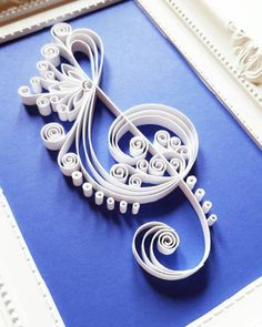 Handmade Quilling Paper Art with Treble Clef.  The treble clef is made with 7mm white paper strips.  Dimensions of the picture: 180x130mm.  Its placed in a white frame with dimensions 230x180mm.  The price includes the frame. The frame does not contain glass.  Please let me know through ETSY Conversation if you have any questions!  more wall art: https://www.etsy.com/shop/Gericards?section_id=16455535&ref=shopsection_leftnav_6  Thank you