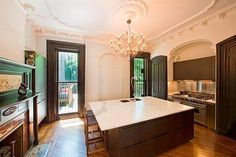 Girls Creator Lena Dunham House Hunts: See the 6 We're Rooting For!: The inlay borders on the wooden floors create a beautiful foundation while the intricate cut glass enhances doors and archways.   : Updated luxuries like state-of-the-art kitchen appliances, custom built floating cabinetry, marble spa tub, and walk-in closets complement a modern lifestyle.