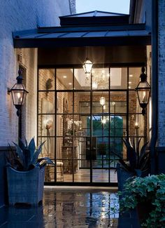 Steel framed modern windows - Minimal - Would look great combined with more rustic and traditional exterior walls - Great breezeway btwn garage and house.