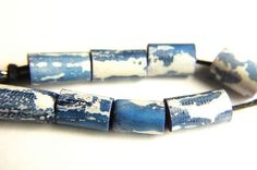 8 small, blue and white, simple pattern, painted and waxed small tube spacer beads. Made of rolled polymer clay, baked, then waxed and buffed to a satin gloss shine. Measuring just under 1/2 (12mm) long and 1/4 (5mm) in diameter approx. 1.5mm bead hole. Follow this link to see more of my rustic style beads and jewelry - https://www.etsy.com/uk/shop/JBDRusticOrganic and for more plain beads, look here - http://etsy.me/2cHue80 AND - If bough...