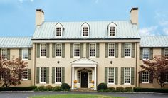 also great look, stucco, and tin roof, very doable, estate manor house, also like the colors