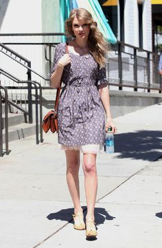 Taylor Swift's Purple Flowery Dress and brown handbag.  Outfit details: http://wwtaylorw.com/424/