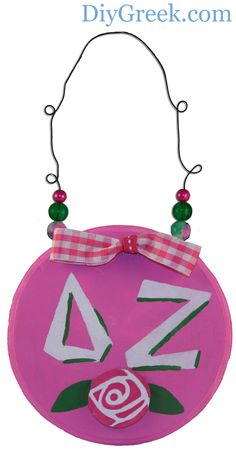 Small Sign for Delta Zeta.  Used so much from DIYGreek.com Supply Sack:  Custom Stencil, Paint, Paint Pens, Ribbon, Beads, Wooden Disks, & Glue.  Such an easy craft idea.  Small Sign is from the Project Pack 4