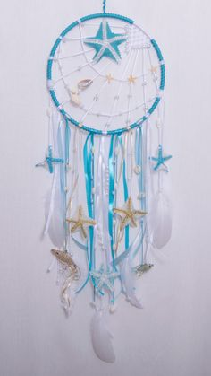 Blue Sea Dream catcher Boho Dreamcatcher Wedding decor Wall hanging Bedroom Mobile Feathers Bohemian Home decor Nursery decor  Each dreamcatcher is individual, handmade, crafted with love and care and may differ slightly from their photo.  This dream catchers measures 10,4(26cm) across and is 31,5(80cm) top to bottom from the longest points.  MATERIAL:  - polypropylene thread - сzech beads - feathers - shells - wooden frame ~~  This dream catcher is made by me with a great enthusiasm in a…