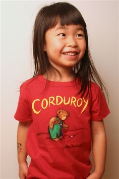 """Cute for a Cause:  """"Purchase of this shirt sends one book to a community in need and supports children's literacy initiatives in the U.S."""""""