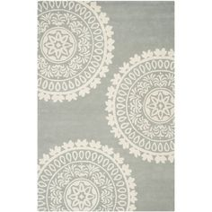 Safavieh's Bella collection is inspired by timeless contemporary designs crafted with the softest wool available. This rug is crafted using a hand tufted construction with a wool pile and features mai