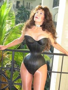 I don't know which is worse - the small waist or the bad boob job--or the shiny nylons, or that weird gaze up into space.... totally strange....