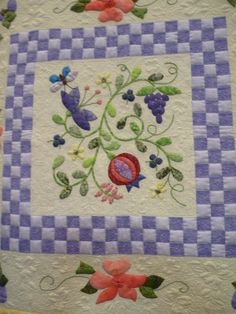 I love the pieced blue and white blocks around the pretty applique. Great design. Sewing & Quilt Gallery: A Quilters' Gathering Show