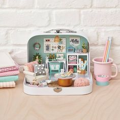 Look… 👀 Is this the most ingenious use of a suitcase ever? We think so. W… Look… 👀 Is this the most ingenious use of a suitcase ever? We think so. We've got four mini makes from in issue 93 to help you create your own dream doll's house too 💙💛💜 Miniature Rooms, Miniature Crafts, Miniature Houses, Diy Dollhouse, Dollhouse Miniatures, Modern Dollhouse Furniture, Mini Doll House, Mollie Makes, Creation Deco